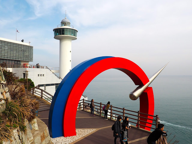 Yeongdo Lighthouse with coloured archway in Taejongdae Park, Busan, South Korea