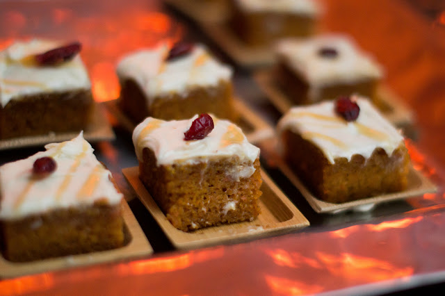 Mini carrot cake squares with cream cheese frosting, sea salt caramel, and dried cranberries