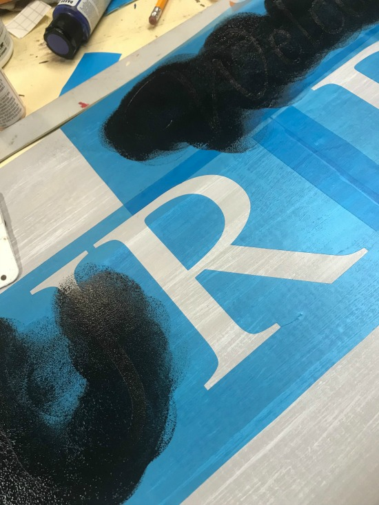 Painting in the stencil with black