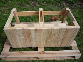finishing the frame of diy pallet wood dry toilet