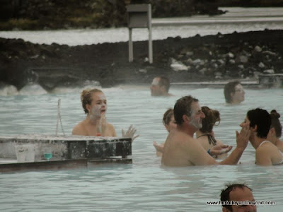 applying silica mud mask at Blue Lagoon in Iceland