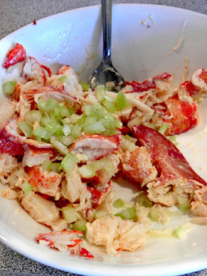 Lobster getting mixed with mayo and chopped celery
