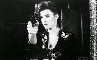 black and white photo of woman pointing a gun