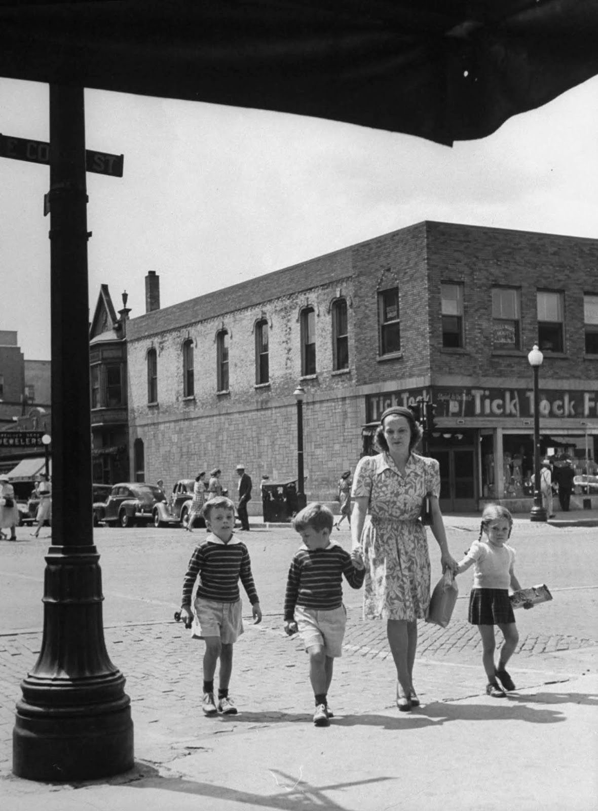 Jane with Peter, Tony and Pamela, as they go to the drugstore to buy ice cream cones, after the boys had haircuts at local barbershop in town.