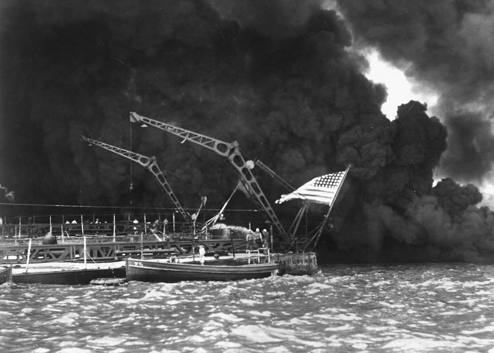 A U.S. flag flies from the stern of the sunken battleship USS West Virginia after the Japanese attack on Pearl Harbor, December 7, 1941.