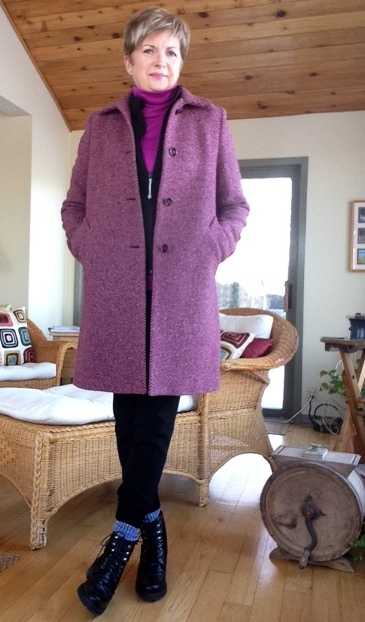 black zippered jacket from Lulu Lemon, pink Hot Chillys base layer turtleneck from Bushtakah, black joggers from Aritzia, black boots from Stuart Weitzman, fuchsia tweed coat from Max Mara