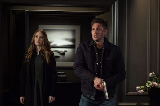 "Kayla Stanton as Jessica and Jensen Ackles as Dean Winchester in Supernatural 13x19 ""Funeralia"""