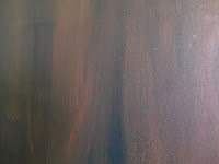 a brown painted canvas