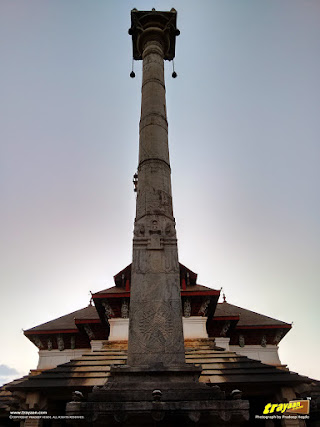50 feet tall pillar or Manasthambha before the Thousand Pillared Jain Temple in Moodabidri, near Mangalore, Karnataka, India - called as Tribhuvana Tilaka Chudamani basadi or Chandranatha basadi, also known as Saavira Kambada Basadi in Dakshina Kannada district, near Mangalore, Mangaluru, Karnataka, India