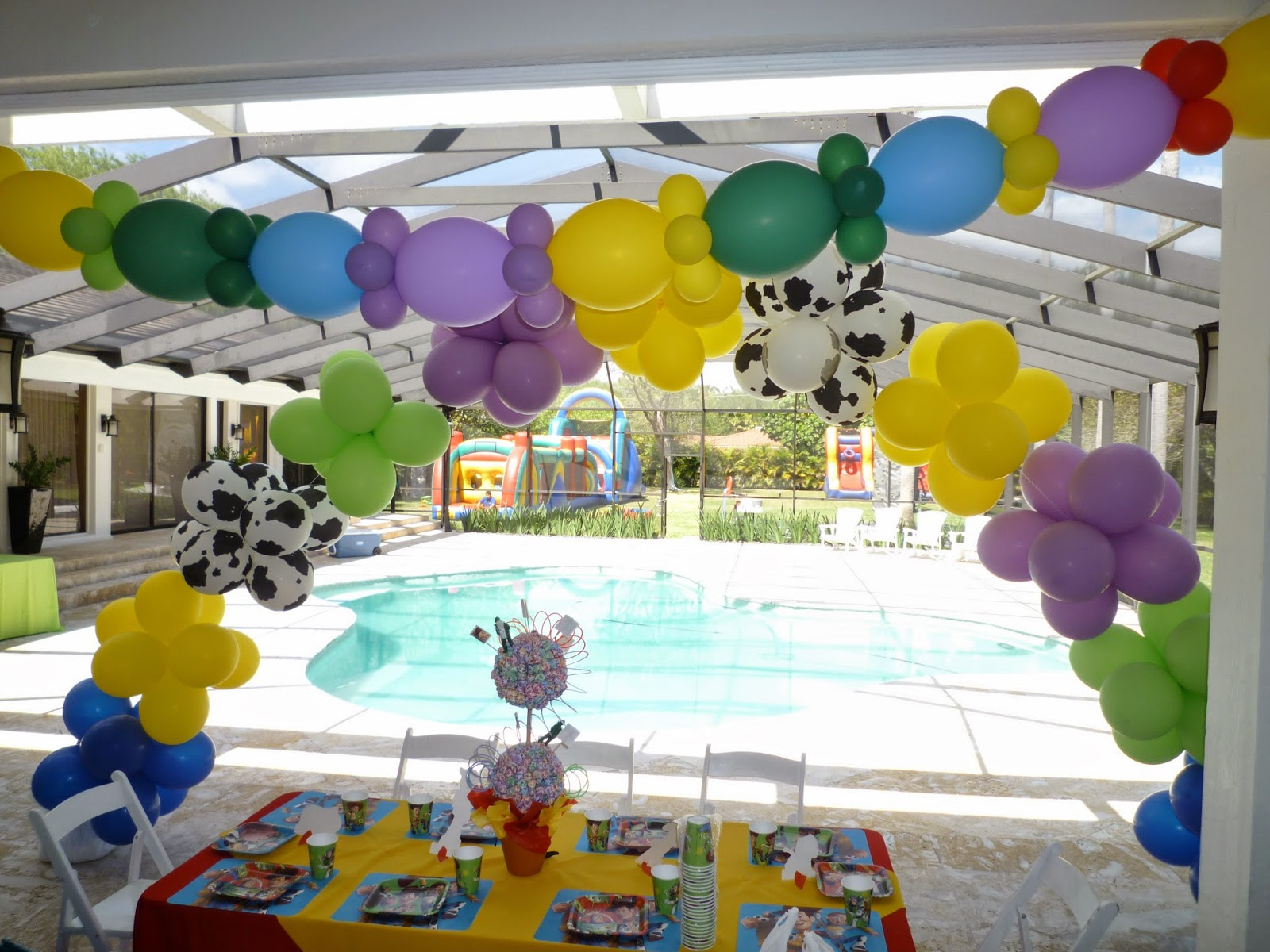 Toy Story kids party balloon arch over a kids table