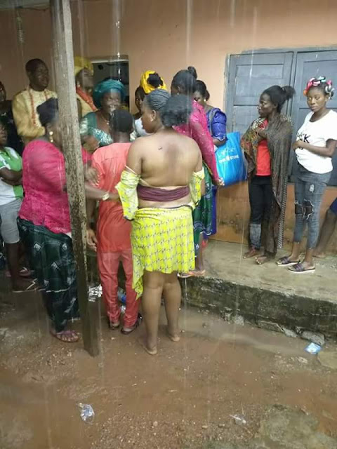 Photos: Woman beaten up and publicly disgraced for allegedly stealing phone, money at a wedding in Delta State