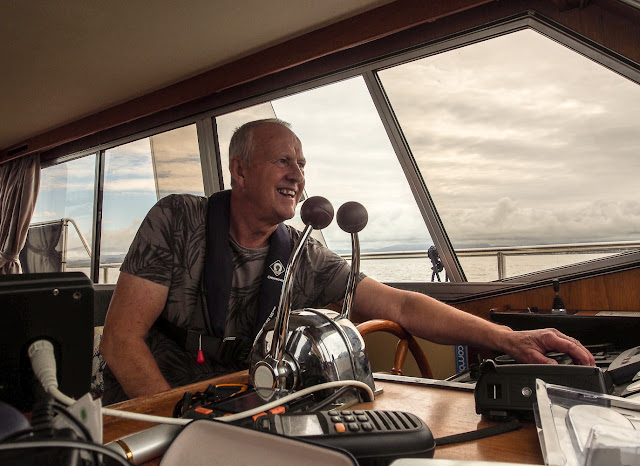 Photo of Phil at the helm