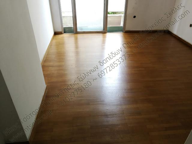 βάψιμο σε ξύλινο πάτωμα απο πατωματζή