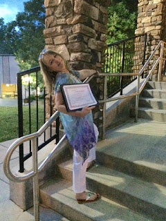 photo of brooke cox holding certificate