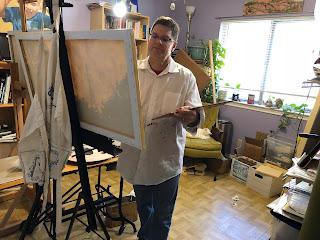 David Borden painting at his easel