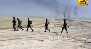 The popular crowd and the federal police arrive at the outskirts of the Wahda neighborhood of Tal Afar