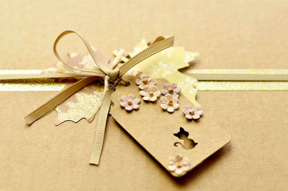 Close up of cookie gift box with ribbon and customised tags by Honeycat Cookies