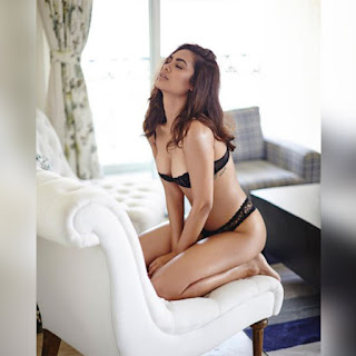 Esha Gupta Sitting On Couch In Black Lingerie