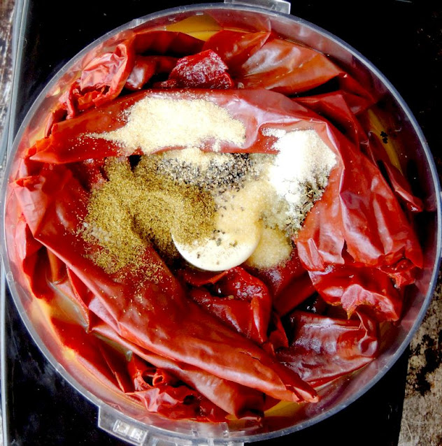 Authentic Homemade Red Chile Enchilada Sauce ingredients in a food processor