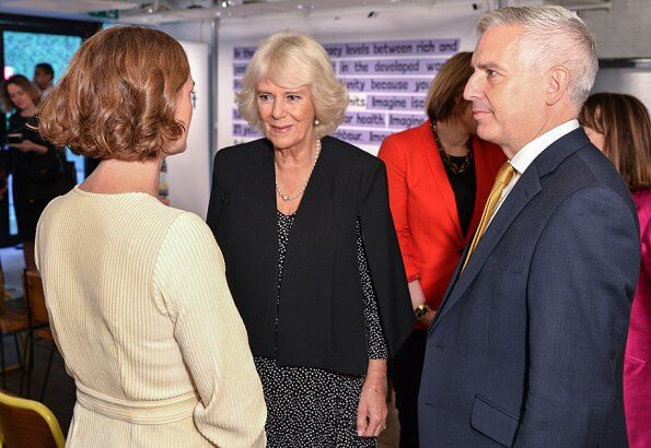 The Duchess of Cornwall sports a chic polka dot dress and ultra stylish cape at a reception for National Literacy Trust
