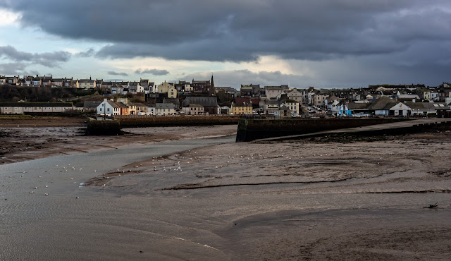 Photo of Maryport from the far side of the basin at low tide