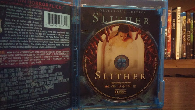 disc art for the scream factory release of slither