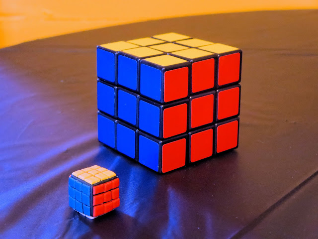 Nerdy Thirty Cake - Fondant Rubik's Cube Decoration next to Real Rubik's Cube