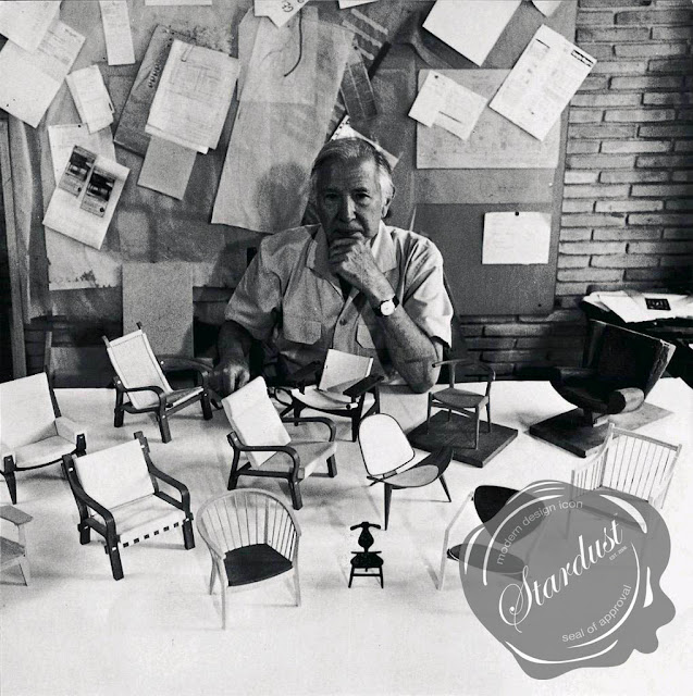 Hans J. Wegner with some of his miniature chair model designs.   In his lifetime Hans J. Wegner designed over 500 different chairs, 100 of which were put into mass production!  Purchase authentic Hans J Wegner design furniture from Stardust Modern Design.