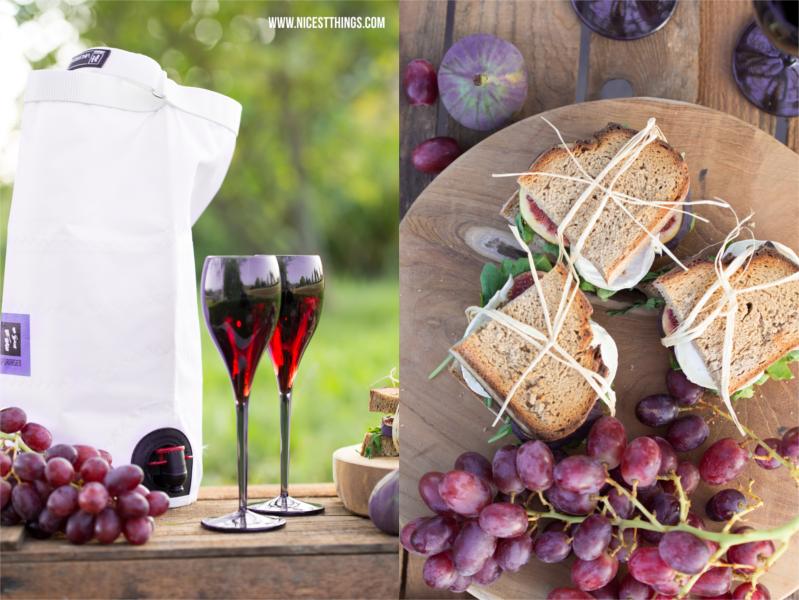 Herbst Picknick Herbstpicknick mit Wein und Ziegenkäse Sandwiches