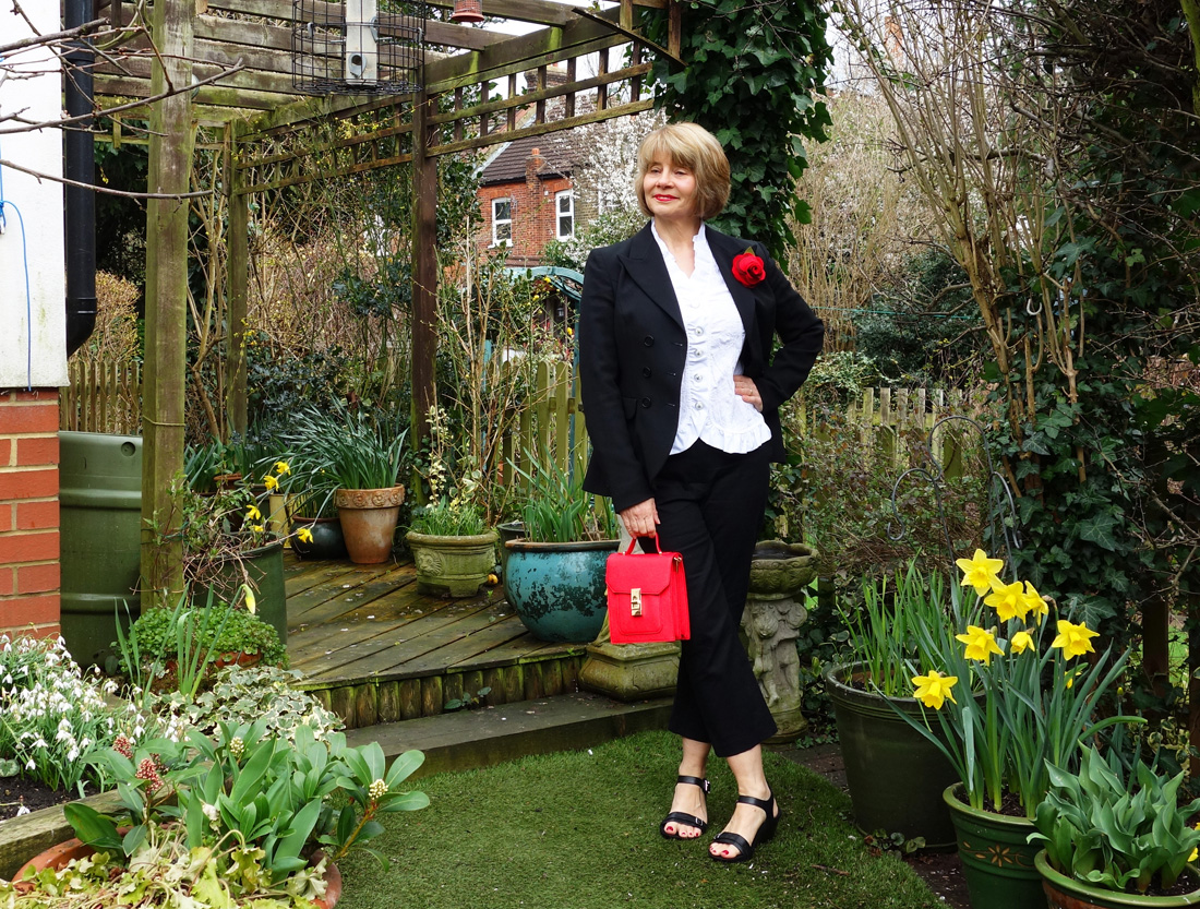Clothes for confidence: black MaxMara jacket, cropped trousers and red accessories