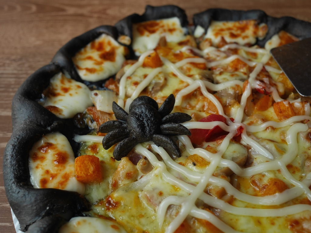 black dough spider on the black halloween pizza at pizza hut in china
