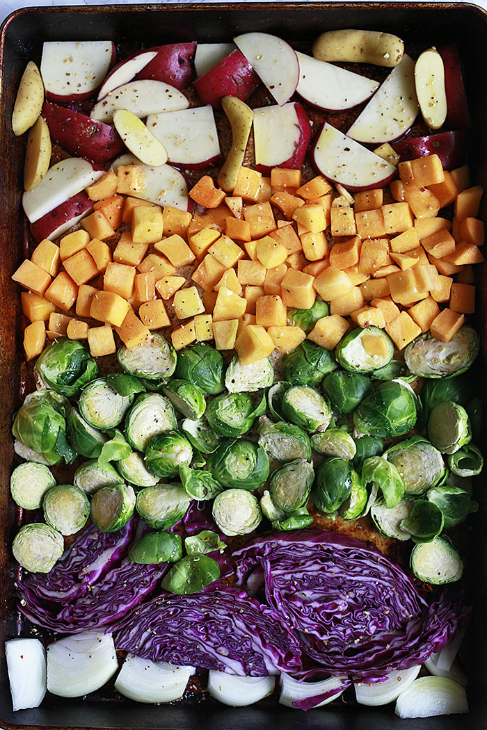 Roasted fall and winter vegetables roasted in a sheet pan for Buddha bowls