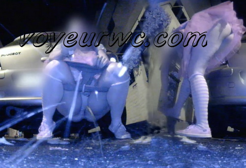Group of desperate drunk girls enjoys to peeing outdoors (Carnival at Night 0002)