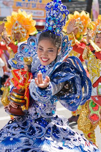 Festival Queen holding a Sto. Nino