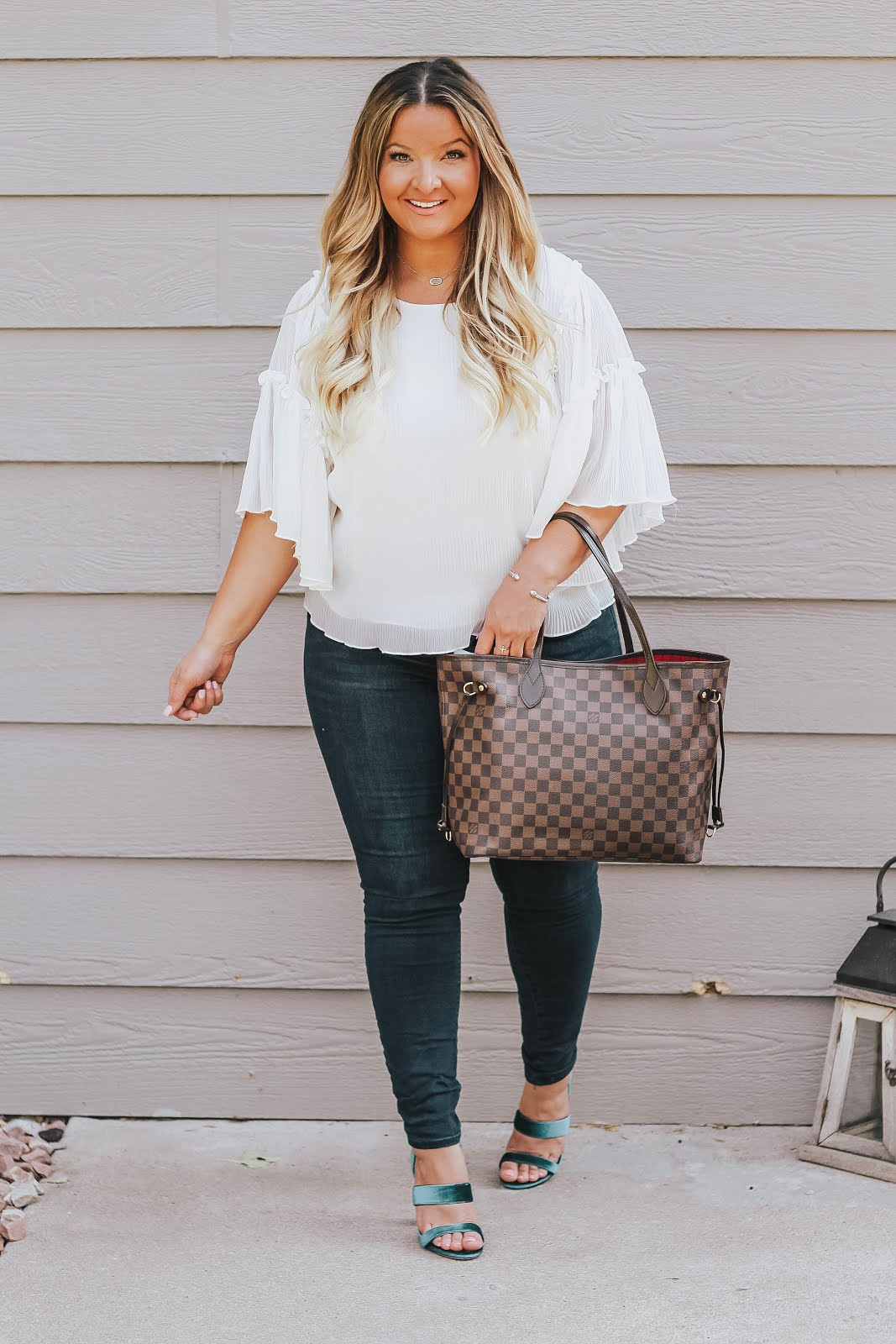 White Flounce Top with Jeans featured by top Denver fashion blog, Delayna Denaye