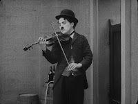 """Кадр из фильма Чарли Чаплина """"Скиталец"""" (1916) - 1"""