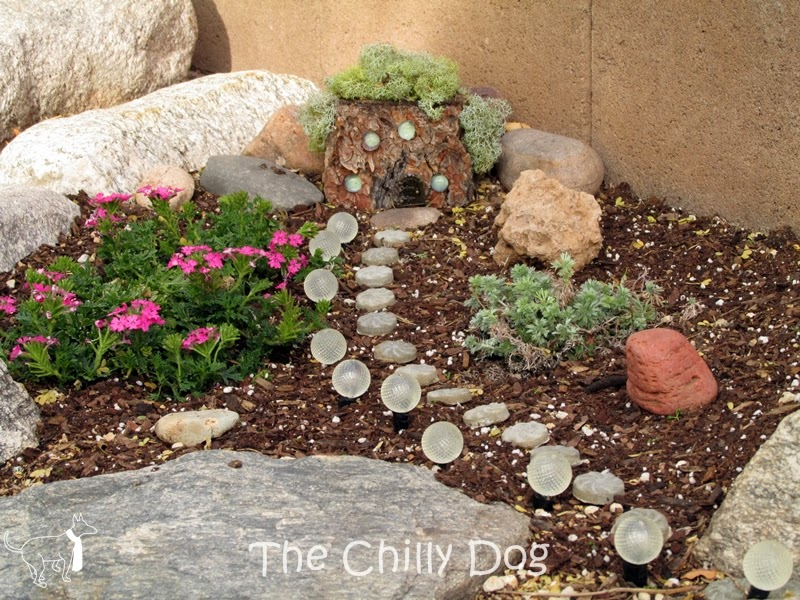 Fairy Garden: Create a rustic fairy house with a log and moss