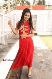 Telugu Actress Priyanka Jain Stills in Red Dress at Amazing Arts Production no 1 Movie Opening  0031.JPG
