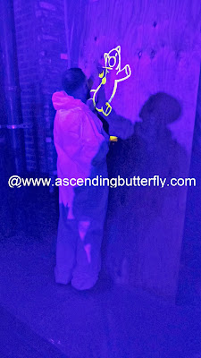 Drawing in a Blacklight room during the Engadget ExpandNY 2013 Technology Tradeshow After Party