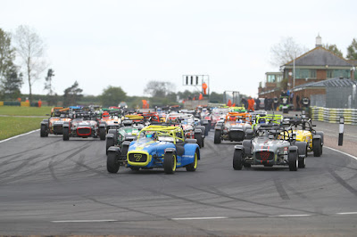 Daniel French leading the pack in into Clervaux Corner in the second of the 2019 Caterham 270R races at Croft Circuit