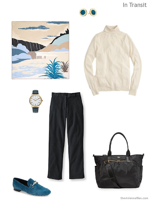 Classic travel outfit in cream and black, with teal accessories