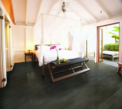 Dark wood or porcelain tile that looks like wood is a practical & beautiful bedroom floor