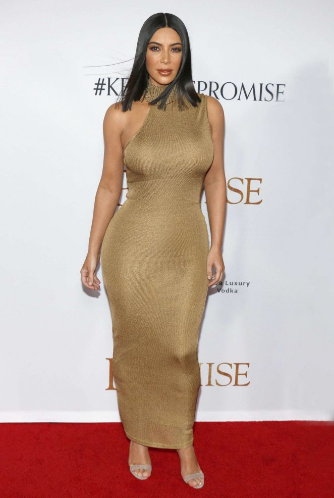 Kim Kardashian wears skintight gold dress to The Promise premiere in LA