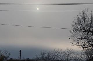 Disc-sun through cloud