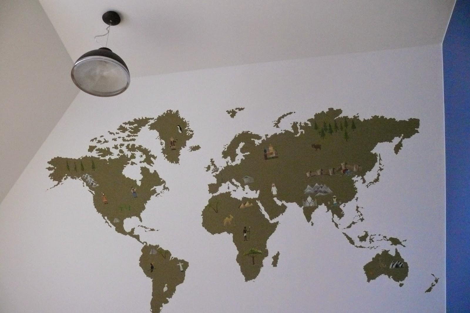 Malowanie mapy świata na ścianie w pokoju noworodka, aranżacja pokoju niemowlęcego