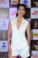 Gauhar Khan in lovely White Shorts and Plunging Neckline Top at Mirchi Music Awards 2016