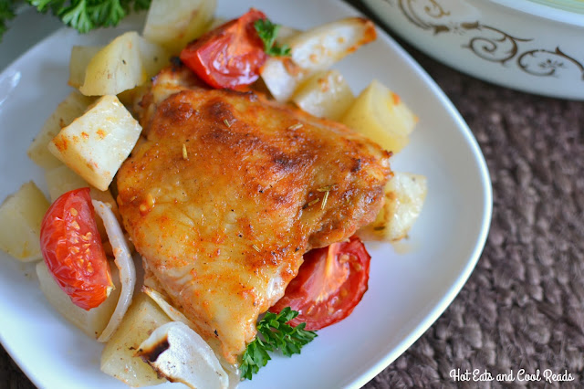 Super easy and delicious chicken with potatoes, tomatoes, onions and garlic! Enough for the whole family and bakes in one hour! One Pan Baked Paprika Chicken with Vegetables Recipe from Hot Eats and Cool Reads