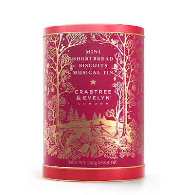A tin of biscuits in red and gold with a Christmas theme