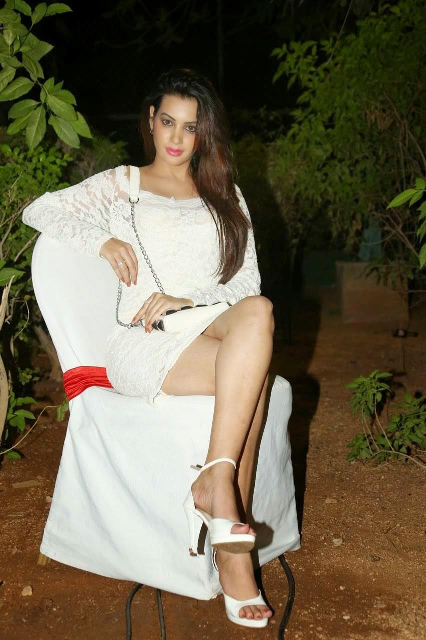 Diksha Panth Unseen Audio Launch Stills, Actress Diksha Panth Crossleg Sitting Pics in White Dress from Event