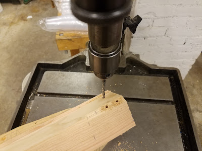 drilling holes at the punch marks